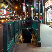 Man getting down to the subway 50 street station in Manhattan, New York City, USA