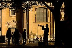 A street musician serenades pedestrians in Antwerp, Belgium. (Photo © Jock Fistick)