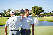 Blaine Hale of Oklahoma celebrates with his coach after birdie on eighteen during the final round of the 3rd annual Kaanapali Classic collegiate invitational. Kaanapali Royal Course Lahaina, Hawaii November 5th, 2016/ Photo by Aric Becker