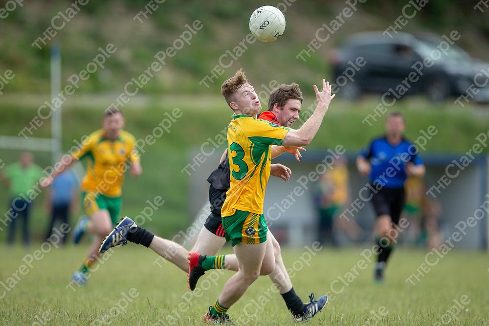 Killimer's David Foran gets the ball ahead of Clondegad's Eamon Breen