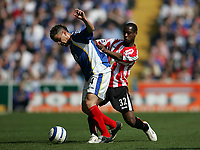 Photo: Lee Earle.<br /> Portsmouth v Sunderland. The Barclays Premiership. 22/04/2006. Pompey's Andres D'Alessandro (L) holds off Justin Hoyte.