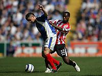 Photo: Lee Earle.<br /> Portsmouth v Sunderland. The Barclays Premiership. 22/04/2006. Pompey's Andres D'Alessandro (L) holds off Justin Hoyte.