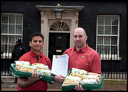 Jitin Dixit from London and Harvey Brown from South west   join subway owner David Cameron to deliver a petition to Downing Street from Subway, Tuesday January 22, 2013. Photo: Andrew Parsons / i-Images