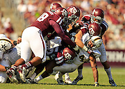 Oct 26, 2013; College Station, TX, USA; Texas A&M Aggies defensive lineman Gavin Stansbury (72) tackles Vanderbilt Commodores running back Wesley Tate (24) during the second half at Kyle Field. Texas A&M won 56-24. Mandatory Credit: Thomas Campbell-USA TODAY Sports