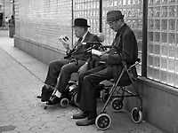 Two men reading on West 72nd street