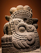 "Statue of Xiuhcoatl. The National Museum of Anthropology (Spanish: Museo Nacional de Antropología, MNA) is a national museum of Mexico. It is the largest and most visited museum in Mexico. Located in the area between Paseo de la Reforma and Mahatma Gandhi Street within Chapultepec Park in Mexico City, the museum contains significant archaeological and anthropological artifacts from the Mexico's pre-Columbian heritage, such as the Stone of the Sun (or the Aztec calendar stone) and the 16th-century Aztec Xochipilli statue. Designed in 1964 by Pedro Ramírez Vázquez, Jorge Campuzano, and Rafael Mijares Alcérreca, the monumental building contains exhibition halls surrounding a courtyard with a huge pond and a vast square concrete umbrella supported by a single slender pillar (known as ""el paraguas"", Spanish for ""the umbrella""). The halls are ringed by gardens, many of which contain outdoor exhibits. The museum has 23 rooms for exhibits and covers an area of 79,700 square meters (almost 8 hectares) or 857,890 square feet (almost 20 acres)."