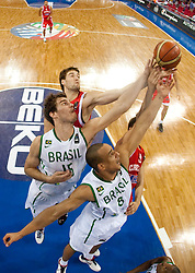 Tiago Splitter of Brasil and Alex Garcia of Brasil vs Luksa Andric of Croatia and Marko Tomas of Croatia during  the Preliminary Round - Group B basketball match between National teams of Brasil and Croatia at 2010 FIBA World Championships on September 2, 2010 at Abdi Ipekci Arena in Istanbul, Turkey. (Photo By Vid Ponikvar / Sportida.com)
