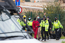 West Hyde, UK. 9th September, 2020. Hertfordshire Police officers arrest anti-HS2 activists who blocked an entrance to the Chiltern Tunnel South Portal site for the HS2 high-speed rail link for the entire day. The protest action, at the site from which HS2 Ltd intends to drill a 10-mile tunnel through the Chilterns, was intended to remind Prime Minister Boris Johnson that he committed to remove deforestation from supply chains and to provide legal protection for 30% of UK land for biodiversity by 2030 at the first UN Summit on Biodiversity on 30th September.