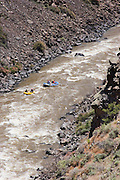 Vertical high view of two rafts on the Rio Grande River near Pilar, New Mexico