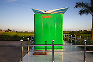 Bright green toilet facility in Duong Lam Village, Son Tay Town, Hanoi outskirts, Vietnam, Southeast Asia