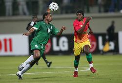 Zambia's Collins Mbesuma and Guinea's Oumar Kalabane battle for the ball