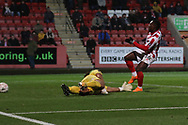 Alex Addai scores and celebrates the 2nd CFC goal during the The FA Cup 1st round replay match between Cheltenham Town and Ebbsfleet at LCI Rail Stadium, Cheltenham, England on 20 November 2018.