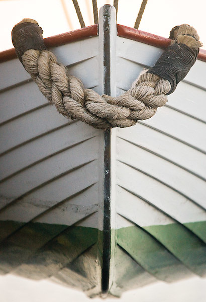 the liberty boat of the full-size replica of the brig, Lady Washington hangs from her stern
