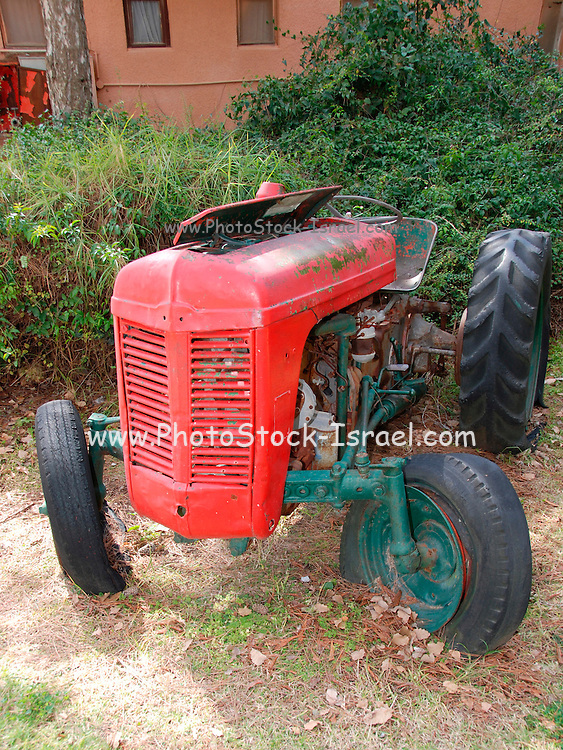 Old disused red tractor