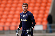 Wimbledon goalkeeper Joe McDonnell (24) warming up  during the EFL Sky Bet League 1 match between Blackpool and AFC Wimbledon at Bloomfield Road, Blackpool, England on 20 October 2018.
