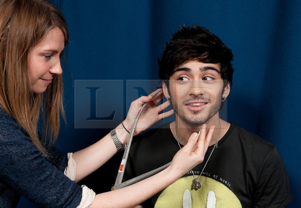© Licensed to London News Pictures. 08/01/2013. London, UK Zayn Malik gets measured for the waxwork model of himself. Madame Tussauds today, 11th March 2013, confirmed all five members of the successful band, One Direction, are to be created as wax figures for a touring attraction in three Madame Tussauds venues - London (April 18-July 11), New York (July 19-October 11) and Sydney (October 24- January 28).. Photo credit : Freerange/LNP