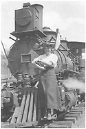 """RGS 2-8-0 #2 front end view with young lady posing on the cow catcher.<br /> RGS  Telluride, CO  ca. 1915<br /> In book """"RGS Story, The Vol. XII: Locomotives and Rolling Stock"""" page 17<br /> Also in """"Silver San Juan"""", p. 591."""