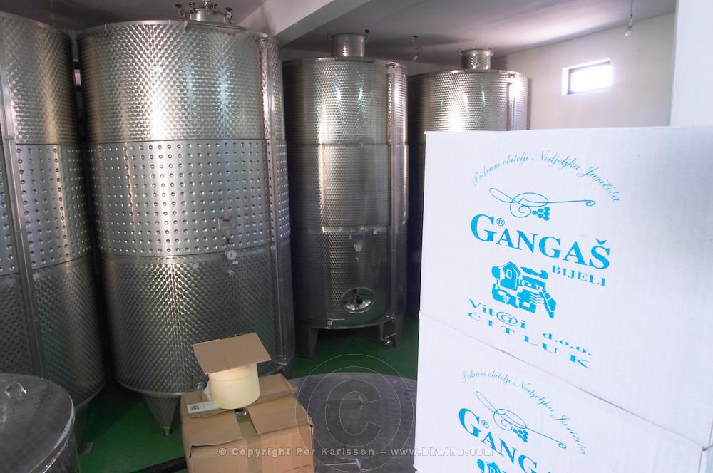 Stainless steel fermentation tanks in the winery. Box in the foreground with the name of the winery. Vita@I Vitaai Vitai Gangas Winery, Citluk, near Mostar. Federation Bosne i Hercegovine. Bosnia Herzegovina, Europe.