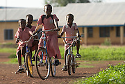 Children ride their bicycles to school in Savelugu, Ghana on Tuesday June 5, 2007.