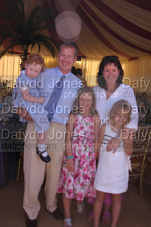 hon Louise Mountbatten, Lord Ivar Mountbatten, Lady Mountbatten, The hon Alex and hon Ella Mountbatten. Veuve Clicquot Gold Cup Final at Cowdray Park. Midhurst. 17 July 2005. ONE TIME USE ONLY - DO NOT ARCHIVE  © Copyright Photograph by Dafydd Jones 66 Stockwell Park Rd. London SW9 0DA Tel 020 7733 0108 www.dafjones.com