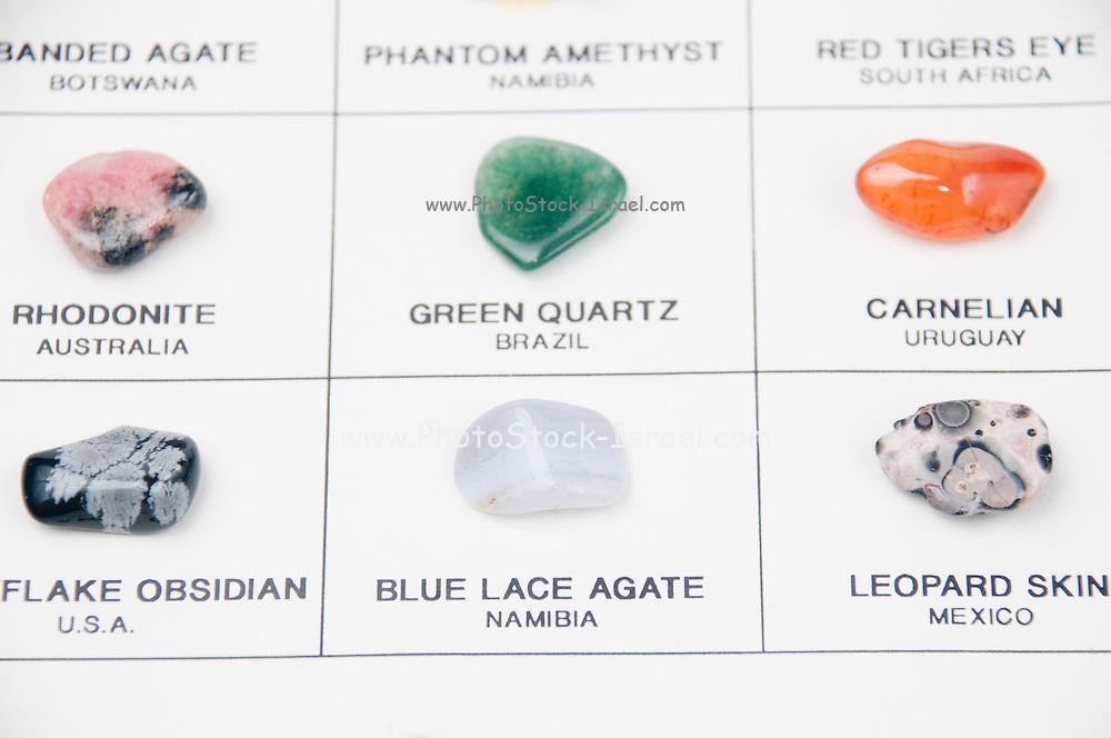 Cutout of a gemstone identification chart on white background