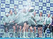 Putney, London, Varsity Boat Race, 07/04/2019, CUBC, President Dara ALIZADEH, holds the Trophy Aloft as the crew, Dave BELL, <br /> James CRACKNELL, <br /> Grant BITLER, <br /> Dara ALIZADEH, <br /> Cullum SULLIVAN, <br /> Sam HOOKWAY, <br /> Freddie DAVIDSON, <br /> Natan WEGRZYCHI-SZYMCZYK, <br /> Cox, Matthew HOLLAND,  celebrate winning the 2019 Oxford V Cambridge, Men's Race, Championship Course,<br /> [Mandatory Credit: Patrick WHITE], Sunday,  07/04/2019,  3:45:31 pm, Crew: