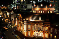 Tokyo Station opened in 1914. During this early era, the station only had gates on the Marunouchi side. Much of the station was destroyed in 1945 during WWII though the station was quickly rebuilt within the year with simple angular roofs. The Marunouchi part of the station was restored to pre-war condition completed in October 2012 . The bombing of Tokyo during World War II caused extensive damage to the Tokyo Station building, shattering the domes which originally adorned the rooftops of the building. Angular rooftops  replaced the domes in the 1946 restoration, but remained until 2012. The surrounding area has been converted into a plaza extending toward the Imperial Palace, reviving the area to its former spacious and lively character.