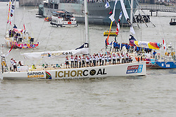© Licensed to London News Pictures. 05/09/2014. London, UK. The IchorCoal Clipper yacht and crew wave as they take part in the final parade in front of Tower Bridge in London on 30th August 2015 after leaving St Katharine Docks to begin the Clipper Round the World Yacht Race 2015. Amateur sailor and paramedic, Andrew Ashman from Orpington in Kent who was sailing on the IchorCoal Clipper died this morning after being hit by a sail whilst the boat was sailing off the Portuguese coast. Photo credit : Vickie Flores/LNP