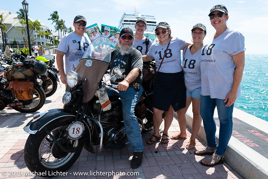Willie Earhart at the finish on his 1948 Harley-Davidson Panhead with his family that greeted him there after the Cross Country Chase motorcycle endurance run from Sault Sainte Marie, MI to Key West, FL. (for vintage bikes from 1930-1948). The Grand Finish in Key West's Mallory Square after the 110 mile Stage-10 ride from Miami to Key West, FL and after covering 2,368 miles of the Cross Country Chase. Sunday, September 15, 2019. Photography ©2019 Michael Lichter.