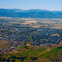Aerial view of Bozeman, Montana, looking south towards the Gallatin Range and Hyalite Mountains.  Montana State University is in left middle ground of city.