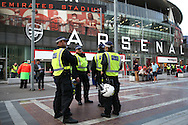 Police officers patrol outside the Emirates Stadium before k/o. UEFA Champions league group A match, Arsenal v FC Basel at the Emirates Stadium in London on Wednesday 28th September 2016.<br /> pic by John Patrick Fletcher, Andrew Orchard sports photography.