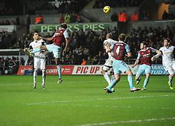 West Ham United's Carlton Cole goes close with a header - Photo mandatory by-line: Joe Meredith/JMP - Tel: Mobile: 07966 386802 27/10/2013 - SPORT - FOOTBALL - Liberty Stadium - Swansea - Swansea City v West Ham United - Barclays Premier League