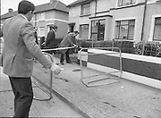 "John O'Grady Rescued By Gardai.   (R67)..1987..05.11.1987..11.05.1987..5th November 1987..After being kidnapped from his home in Cabinteely, Co Dublin, John O'Grady was finally rescued after twenty one days in captivity. he was located in a house inCarnlough Road, Cabra West, Dublin. During his ordeal Mr O""Grady was mutilated by the kidnappers led by Dessie O'Hare to apply pressure on his family to pay the ransom sought. In an ensuing gun battle with the kidnappers a detective garda was shot and seriously wounded. In the chaos that followed the kidnappers escaped and were not all captured for a further three weeks after a massive manhunt...Image shows Garda technical officers as they secure the scene for forensic tests."