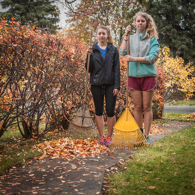 Kayla Jackson and Holly Furman rake leaves, Anchorage