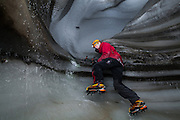 Stephen Jennings climbs a short step in an ice cave in Larsbreen, Svalbard.