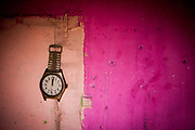 """A watch in the flat of  Milena and their family at the concrete building """"Hrebenova 34-36"""" which was in an appalling condition and demolished in August 2014 by the city of Kosice. The family of Milena, her mother Bozena and their children had been one of the last families living in that building waiting for a compensatory flat which they received a short while later. They belonged among the 5% of inhabitants of that building which had a renting contract, were paying rent and with that the right to get a new flat at the housing estate."""