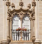 Architectural detail of Manueline historic window frame in old building city of Evora, Alto Alentejo, Portugal
