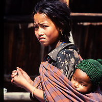 A young woman carries a baby in the Manang Valley north of Annapurna in Nepal.