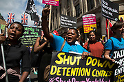 Black Lives Matter supporters calling for a shut down of detention centres at the Peoples Assembly demonstration: No More Austerity - No To Racism - Tories Must Go, on Saturday July 16th in London, United Kingdom. Tens of thousands of people gathered to protest in a march through the capital protesting against the Conservative Party cuts. Almost 150 Councillors from across the country have signed a letter criticising the Government for funding cuts and and will be joining those marching in London. The letter followed the recent budget in which the Government laid out plans to cut support for disabled people while offering tax breaks for big business and the wealthy. (photo by Mike Kemp/In Pictures via Getty Images)
