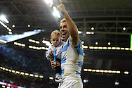 Argentina 's no 8 Leonardo Senatore celebrates with a young child at the end of the match after his team win to reach the semi-finals. Rugby World Cup 2015 quarter-final match, Ireland v Argentina at the Millennium Stadium in Cardiff, South Wales  on Sunday 18th October 2015.<br /> pic by  Andrew Orchard, Andrew Orchard sports photography.