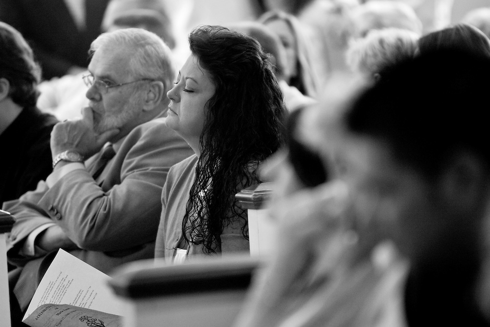 Marie's daughter Tracie holds back tears during her mother's memorial service on Sept. 18, 2009.