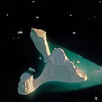 An iceberg floats near the Antarctic Peninsula, Antarctica.