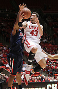 Utah guard Cedric Martin (43) attempts to score past Arizona guard Josiah Turner (11) during the first half of an NCAA college basketball game, Wednesday, Jan. 19, 2012, in Salt Lake City, Utah. (AP Photo/Colin E Braley)
