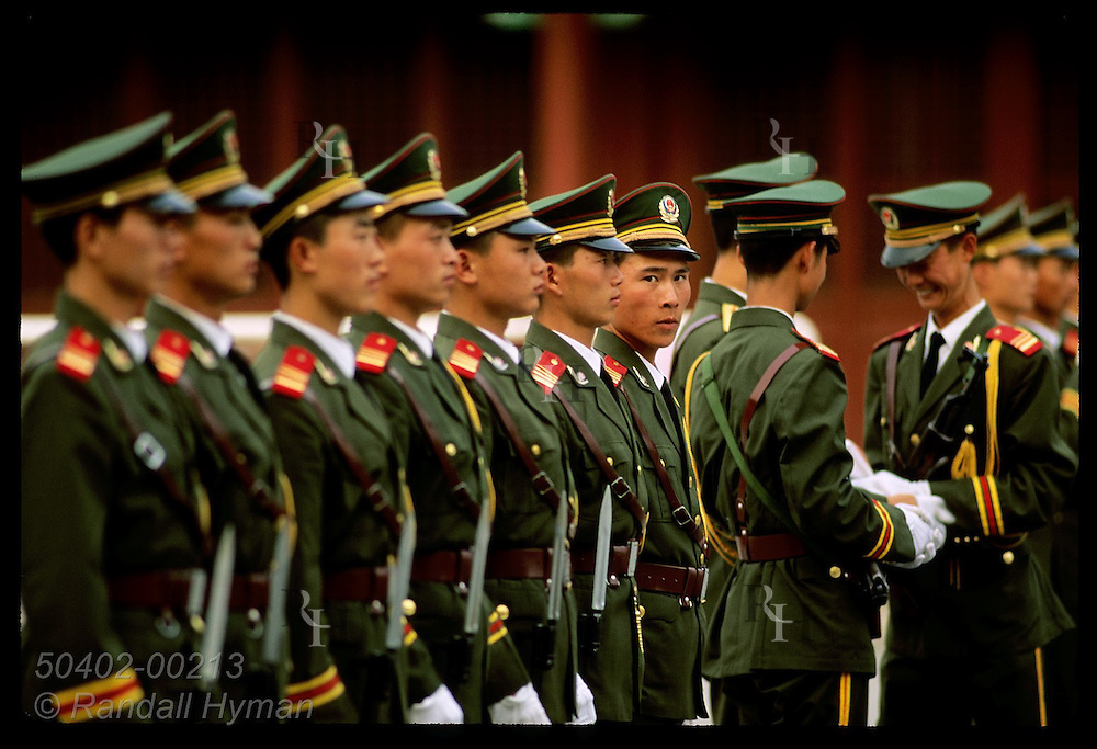 One soldier breaks form as he glances to side at dress inspection outside Forbidden City; Beijing. China