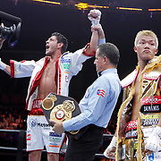 Tomoki Kameda, right, reacts to losing to Jaime McDonnell   in their Premier Boxing Champions Bantamweight Championship fight at the State Farm Arena in Hidalgo, Texas. McDonnell won the bout with all three judges scoring it 114-113.<br /> Nathan Lambrecht/The Monitor