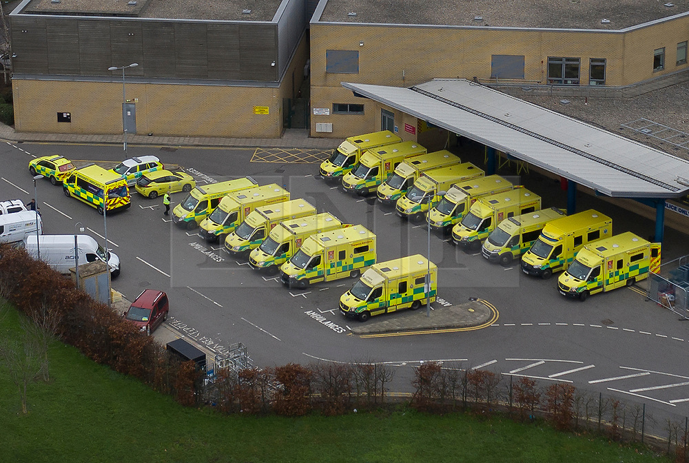 © Licensed to London News Pictures. 29/12/2020. Romford, UK. A row of ambulances are parked up at the A&E entrance to Queen's Hospital in Romford, east London. A record of 41,385 cases of Covid-19 infections was reported on Monday and the number of people being treated for the virus in hospital has now reached 20,426, which is greater that the previous peak of about 19,000 in April. Photo credit: Peter Macdiarmid/LNP