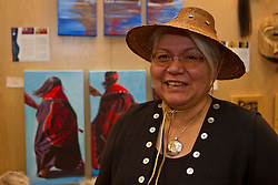 Teslin artist Jean Taylor at the Yukon First Nations booth at the 2010 Olympics