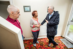 Labour leader Jeremy Corbyn meets Joan Robson and her husband Brian Robson (left) while on the campaign trail in Grimsby ahead of the local elections.