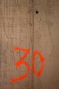 Number 30 identifies floor number on New York City construction site.
