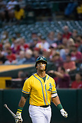 Oakland Athletics designated hitter Khris Davis (2) walks away from the batter's box after striking out against the Los Angeles Angels at Oakland Coliseum in Oakland, California, on September 5, 2017. (Stan Olszewski/Special to S.F. Examiner)